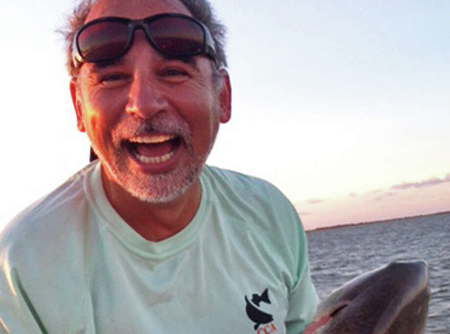 Wanting the fishing trip to be special for his wife, a jubilant Mike Boyer of San Antonio holds the tagged redfish that won him a new pickup, boat and trailer in the CCA Texas STAR Tournament. Photo: Courtesy Photo