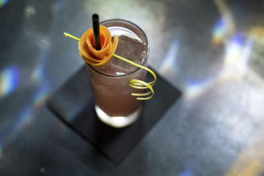 The Velveteen Flower, a popular drink with a vodka and grapefruit base in addition to Chambord, Cocchi Americano, honey, lime and Topo Chico at Juniper Tar. Photo: Express-News File Photo / © 2016 San Antonio Express-News