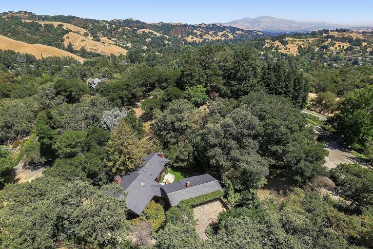 Terraced gardens with mature trees dominate the Lafayette property.