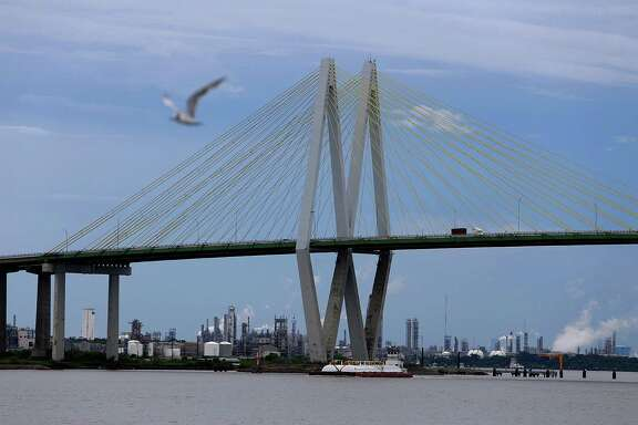The Fred Hartman Bridge spans the Houston Ship Channel, Wednesday, Aug. 17, 2016, in Houston. A group of infrastructure experts met Wednesday at the Port of Houston Authority for a round table discussion on both water and land freight transportation. The discussion was part of the American Association of Port Authorities' Seaport Influencer Roundtable and Media Tour series, and it was followed with a tour of the Port of Houston. Media and industry experts received a ship channel tour from a Houston Pilots' boat and then a bus tour of the Bayport Container Terminal andlogistics company Katoen Natie's plastic resin packaging complex.