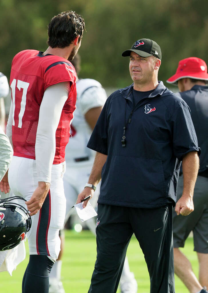 Houston Texans quarterback Brock Osweiler (17) talks to head coach Bill O'Brien during a joint training camp practice between the Texans and Saints at Houston Methodist Training Center on Thursday, Aug. 18, 2016, in Houston.