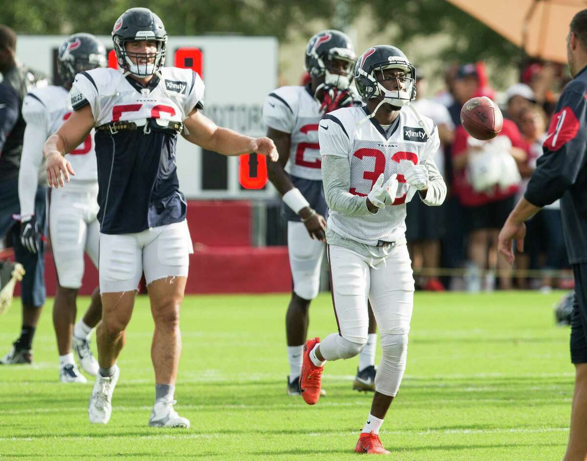Houston Texans defensive back Robert Nelson (32) flips a football during warm ups during a joint training camp practice between the Texans and the New Orleans Saints at Houston Methodist Training Center on Thursday, Aug. 18, 2016, in Houston.