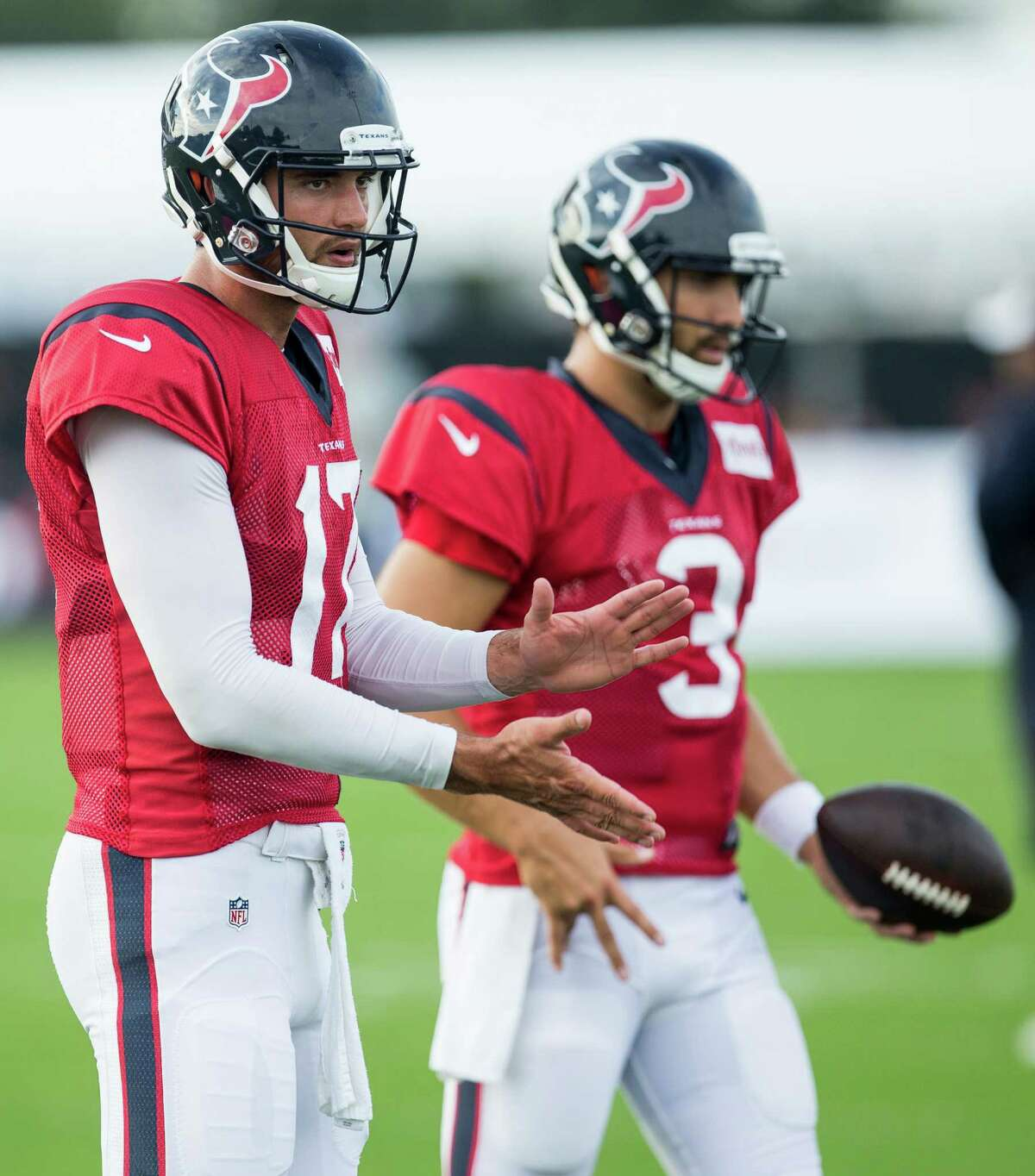 Houston Texans quarterbacks Brock Osweiler (17) and Tom Savage (3) warm up during a joint training camp practice between the Texans and Saints at Houston Methodist Training Center on Thursday, Aug. 18, 2016, in Houston.