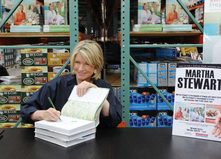 "Martha Stewart signs copies of her new book, ""Martha Stewart's Encyclopedia of Sewing and Fabric Crafts"" and bestsellers ""Martha Stewart's Encyclopedia of Crafts"" and ""Everyday Food: Fresh Flavor East"" at Costco in Norwalk, Conn. on Thursday April 29, 2010. Photo: Kathleen O'Rourke, ST / Stamford Advocate"