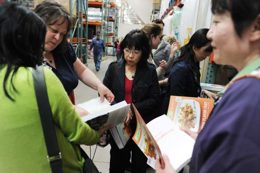 A group of women wait in line as Martha Stewart signs copies of her new book,