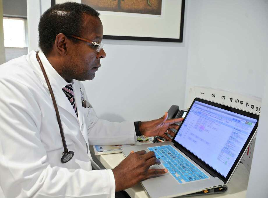 Doctor Jacques Etienne MD, records patient note in a laptop at the new Optimum Medical location, 48 Main Street, in Danbury. Wednesday, August 17, 2016, in Danbury, Conn. Photo: H John Voorhees III / Hearst Connecticut Media / The News-Times
