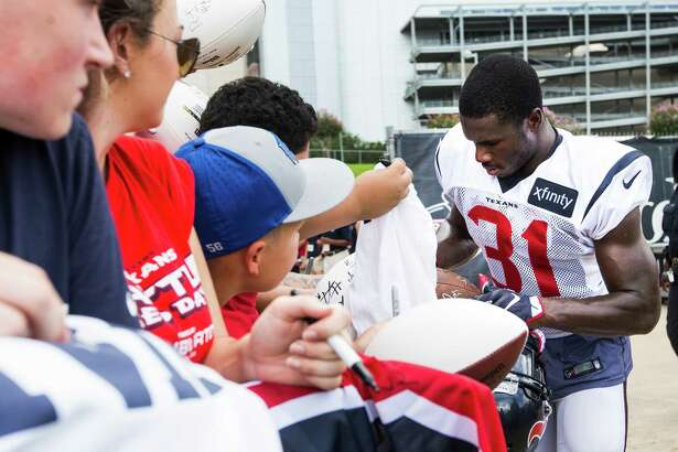 Houston Texans defensive back Charles James (31) signs autographs following a joint training camp practice between the Texans and the New Orleans Saints at Houston Methodist Training Center on Thursday, Aug. 18, 2016, in Houston.