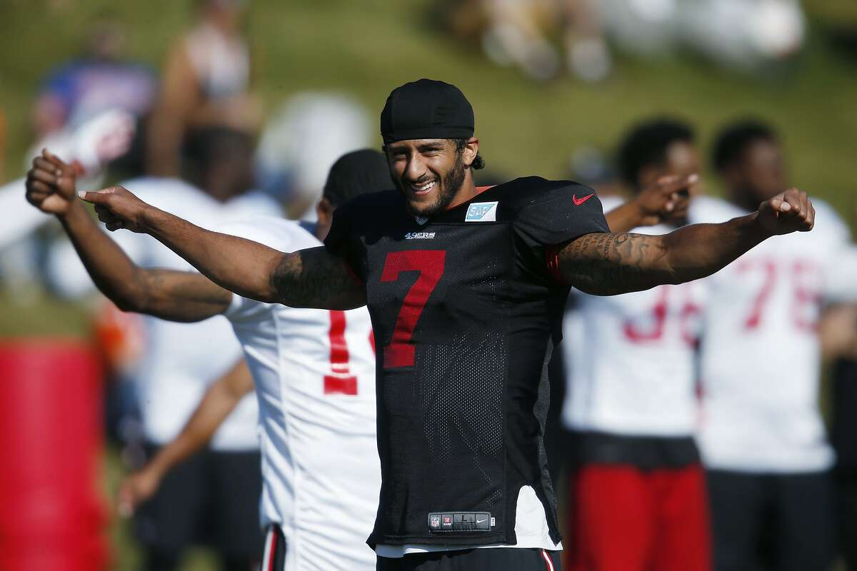 San Francisco 49ers quarterback Colin Kaepernick stretches as players prepare to take part in drills against the Denver Broncos during the teams' joint NFL football training camp session Thursday, Aug. 18, 2016, in Englewood, Colo. (AP Photo/David Zalubowski)