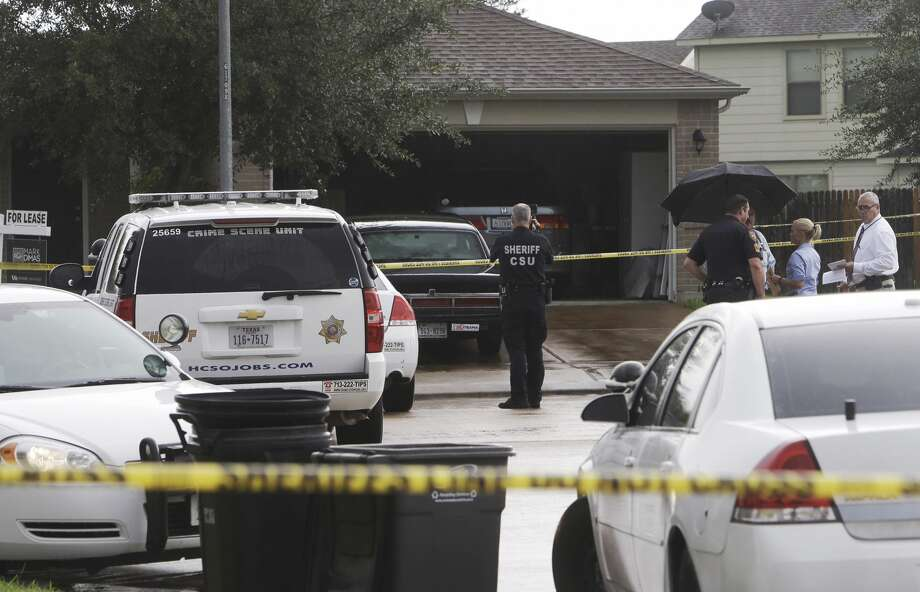 Police are shown at a scene where three people were killed in a shooting at a home in the 7700 block of Balsam Crossing Lane, Thursday, Aug. 18, 2016, in Cypress . Photo: Melissa Phillip / Houston Chronicle