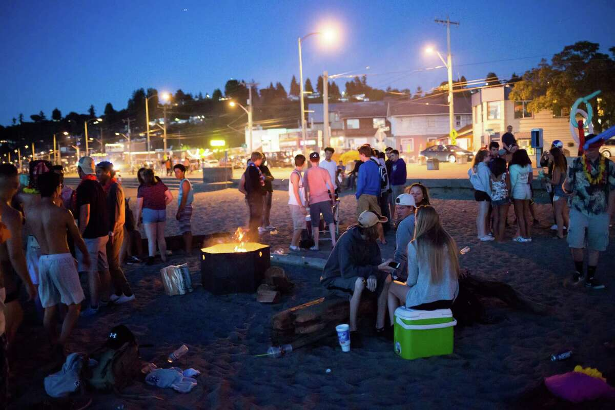 Teens party on Alki Beach, July 27, 2016.