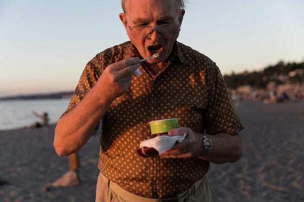 David Dunn eats up his pistachio ice-cream at the south end of Alki Beach on Aug. 16, 2016.