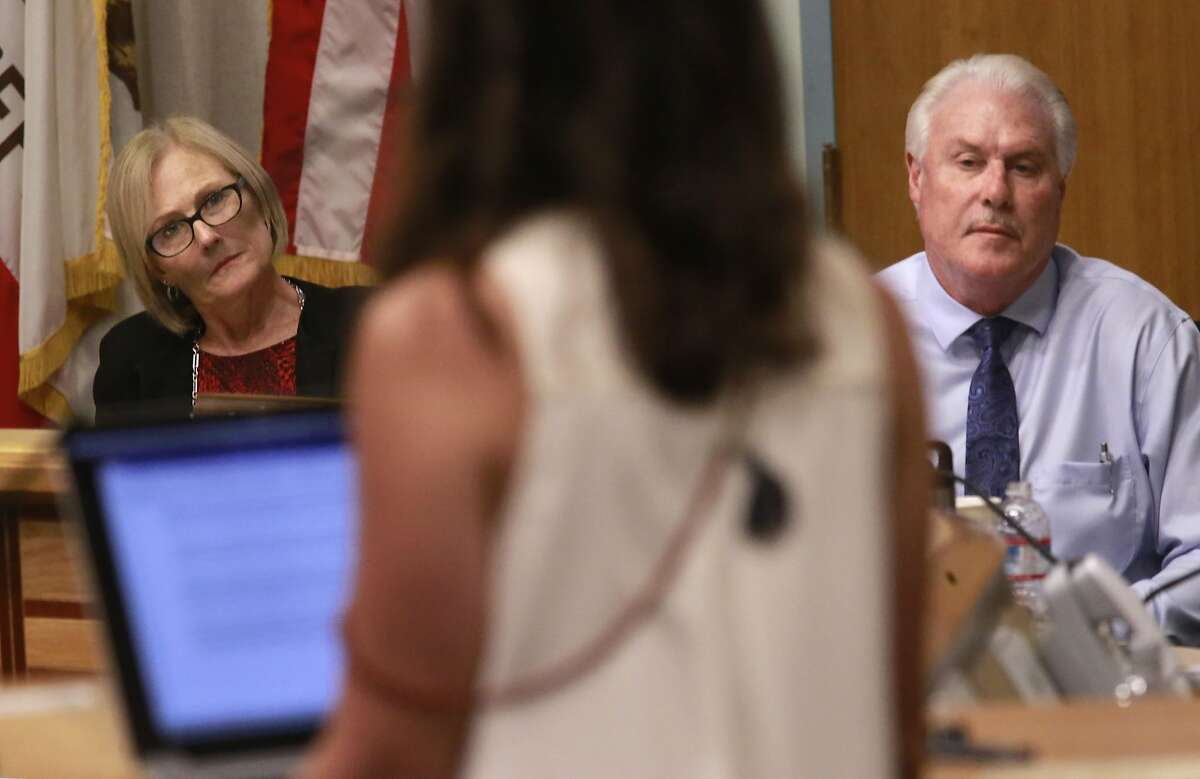 Board members Marly Hart and Dave Thomas listen to public comments during a hearing in Walnut Creek on Thurs. Aug. 18, 2016, held by the California State Occupational Safety and Health Standards Board to discuss the issue of requiring adult performers to use condoms.