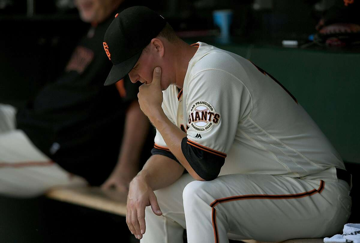 SAN FRANCISCO, CA - AUGUST 17: Pitcher Matt Cain #18 of the San Francisco Giants sits in the dugout after he was taken out of the game against the Pittsburgh Pirates in the top of the fifth inning at AT&T Park on August 17, 2016 in San Francisco, California. (Photo by Thearon W. Henderson/Getty Images)