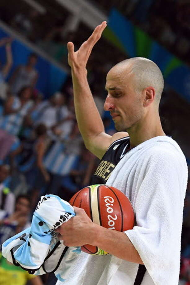 Argentina's shooting guard Manu Ginobili gestures as he leaves the court after losing to USA during a Men's quarterfinal basketball match between USA and Argentina at the Carioca Arena 1 in Rio de Janeiro on August 17, 2016 during the Rio 2016 Olympic Games. / AFP PHOTO / Mark RALSTONMARK RALSTON/AFP/Getty Images Photo: MARK RALSTON/AFP/Getty Images