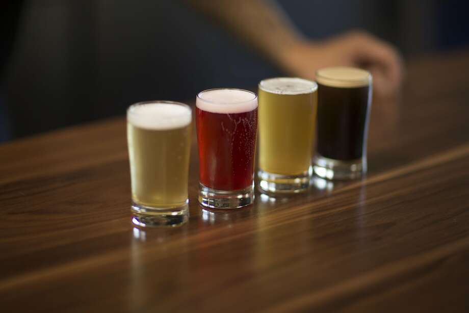 A beer flight ($12) allows a sampling of four Loma beers. Photo: Travis Mocker