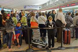 DENVER, CO - MARCH 20: Travelers, many on spring break, wait in lines to check in for their Frontier Airlines flights at Denver International Airport, March 20, 2015. Frontier Airlines is see customer complaints on the rise. (Photo by RJ Sangosti/The Denver Post via Getty Images)