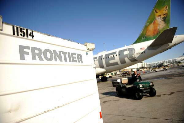 Frontier Airlines at DIA in Denver, Colorado, Thursday, December 2, 2011. The Denver-hubbed carrier will be financially independent by the end of the second quarter 2012, but parent company Republic Airways must become a minority owner under an agreement with Frontier pilots. Hyoung Chang, The Denver Post  (Photo By Hyoung Chang/The Denver Post via Getty Images)