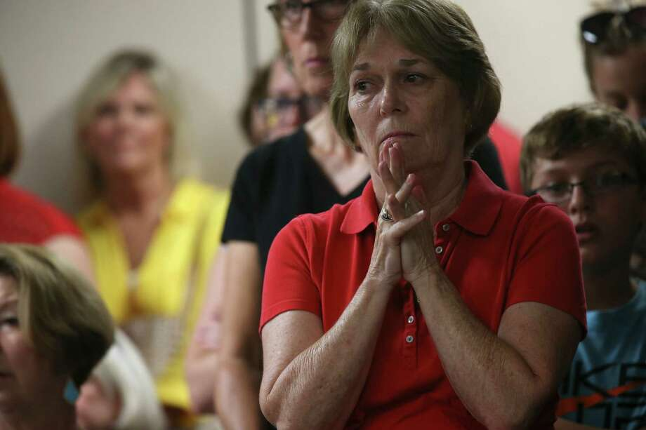 A woman reacts as the Sequin Independent School District boards discusses a proposed partnership with Guadalupe Media, LTD, during a Special Meeting, Thursday, August 18, 2016. The partnership would let the district operate KWED radio station and also a free local daily newspaper. After meeting in executive session, the board came out and voted 6-1 in favor of negotiating with the company for the partnership. Photo: Photos By Jerry Lara / San Antonio Express-News / © 2016 San Antonio Express-News