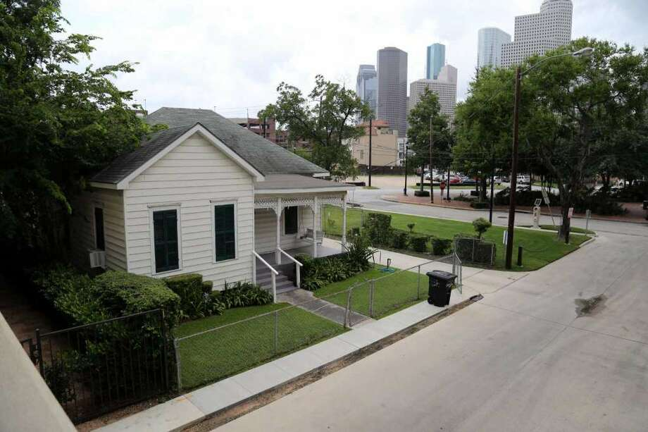 The home is the last remaining residence on the small street off West Gray in Houston's Fourth Ward. (Billy Smith II / Houston Chronicle) Photo: Fsrweirdz