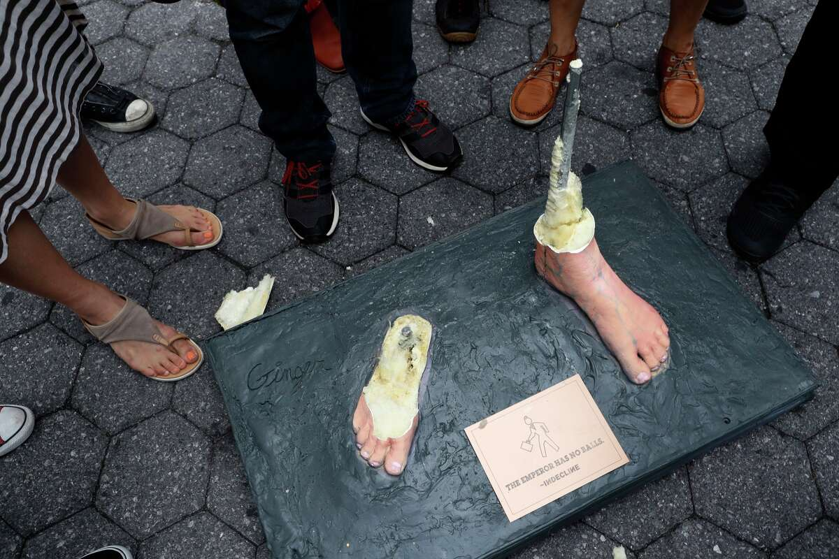 The base and feet of a statue of a naked Republican presidential candidate Donald Trump is all that it left after New York City Department of Parks & Recreation employees removed it, Thursday, Aug. 18, 2016, in New York's Union Square. (AP Photo/Mary Altaffer)