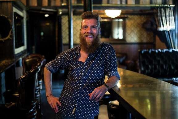 General Manager Benjamin Krick tends bar at Juniper Tar.
