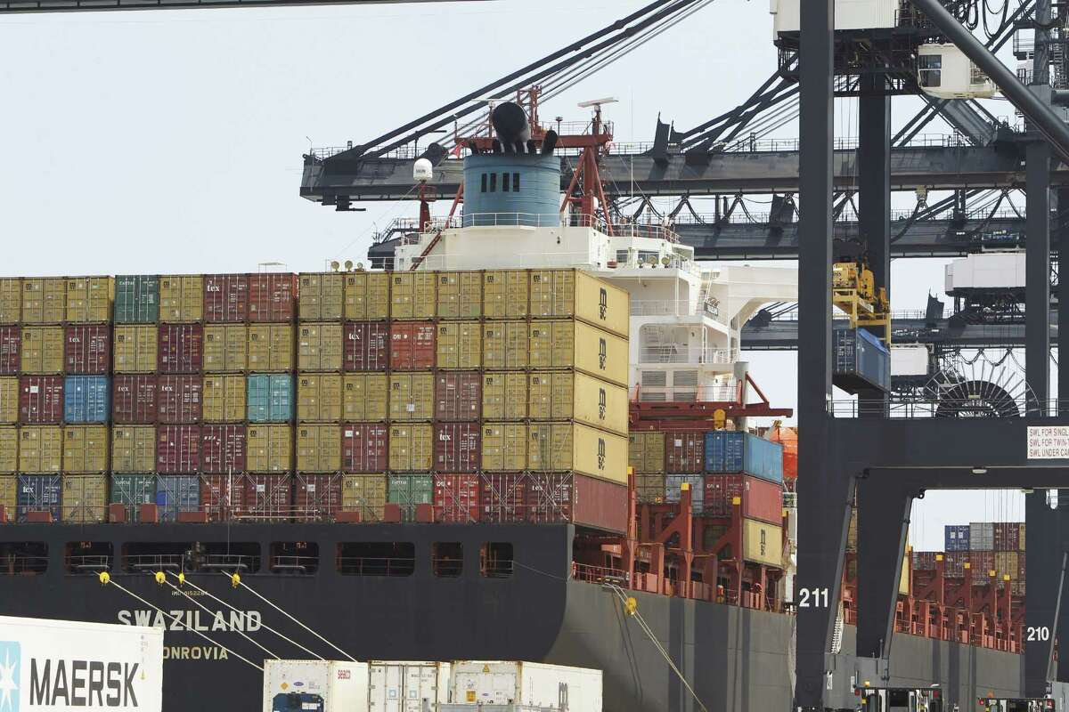 """A container ship at a Port of Houston Authority dock is seen, Aug. 13, 2015. The stakes and opportunities to trade with TPP-member countries are massive. According to the U.S. trade office, American companies �"""" big and small �"""" exported more than $622 billion in goods to TPP-member countries in 2013. The TPP provides the opportunity to massively expand this trade. ( Steve Gonzales / Houston Chronicle )"""