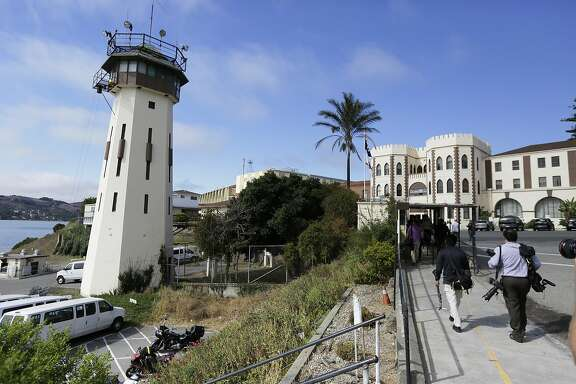People walk toward a main entrance at San Quentin State Prison Tuesday, Aug. 16, 2016, in San Quentin, Calif. (AP Photo/Eric Risberg)
