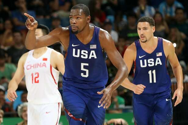RIO DE JANEIRO, BRAZIL - AUGUST 06: Kevin Durant #5 of United States celebrates a basket as Gen Li #12 of China and Klay Thompson #11 of the United States look on against China on Day 1 of the Rio 2016 Olympic Games at Carioca Arena 1 on August 6, 2016 in Rio de Janeiro, Brazil.  (Photo by Rob Carr/Getty Images)