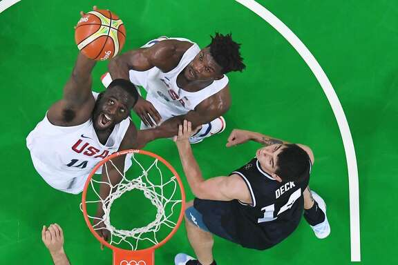 An overview shows USA's forward Draymond Green (L) scoring by Argentina's small forward Gabriel Deck during a Men's quarterfinal basketball match between USA and Argentina at the Carioca Arena 1 in Rio de Janeiro on August 17, 2016 during the Rio 2016 Olympic Games. / AFP PHOTO / Andrej ISAKOVICANDREJ ISAKOVIC/AFP/Getty Images