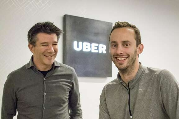 Uber CEO Travis Kalanick, left, and Anthony Levandowski, co-founder of Otto, pose for a photo in the lobby of Uber headquarters, Thursday, Aug. 18, 2016, in San Francisco. Uber announced that it is acquiring self-driving startup Otto, which has developed technology allowing big rigs to drive themselves. (AP Photo/Tony Avelar)