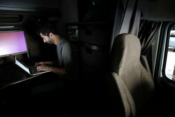 Software engineer Eyal Cohen of Otto, led by 15 former Google engineers, codes in the cab of one of the company�s big rig trucks in San Francisco, May 16, 2016. The engineers believe that automating trucks rather than passenger vehicles could be more palatable financially and to regulators. (Ramin Rahimian/The New York Times)