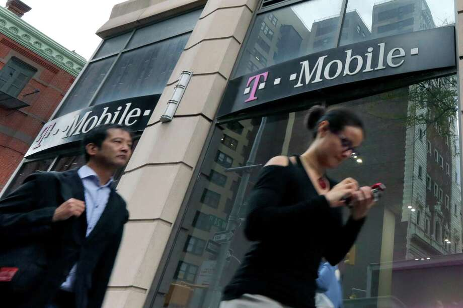 T-Mobile announced Thursday that it is eliminating data limits for new customers and reducing the cost of data plans. Sprint also announced a lower-cost family plan. Photo: Richard Drew /Associated Press / Copyright 2016 The Associated Press. All rights reserved. This material may not be published, broadcast, rewritten or redistribu