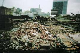 John Revelli snapped this photograph of his tire shop in ruins on the day it was demolished. Revelli returned to the site of his former tire business in downtown Oakland, Calif. on Friday, June 23, 2006. The Oakland Redevelopment Agency took his business, which his family had owned since 1949, through eminent domain proceedings so a developer could construct a huge apartment complex. PHOTO: COURTESY OF JOHN REVELLI **John Revelli