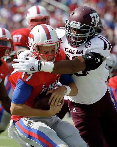 Linebacker Shaan Washington, right, believes his position will be one of Texas A&M's strengths this season after being weak against the run in 2015. Photo: Tony Gutierrez, STF / AP
