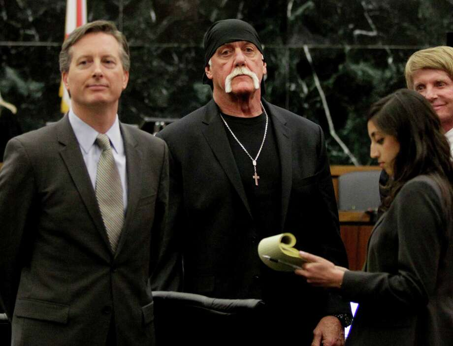 FILE - In this Monday, March 21, 2016, file photo, Hulk Hogan, whose given name is Terry Bollea, center, looks on in court moments after a jury returned its decision in St. Petersburg, Fla. Hogan sued Gawker for invasion of privacy and, bankrolled by tech billionaire Peter Thiel, won a $140 million judgment that led to Gawker's bankruptcy filing. Gawker.com is going to shut down as its parent company is sold to Univision, a reporter for the 14-year-old site said Thursday, Aug. 18, 2016. (Dirk Shadd/The Tampa Bay Times via AP, Pool, File) Photo: Dirk Shadd, POOL / Pool Tampa Bay Times