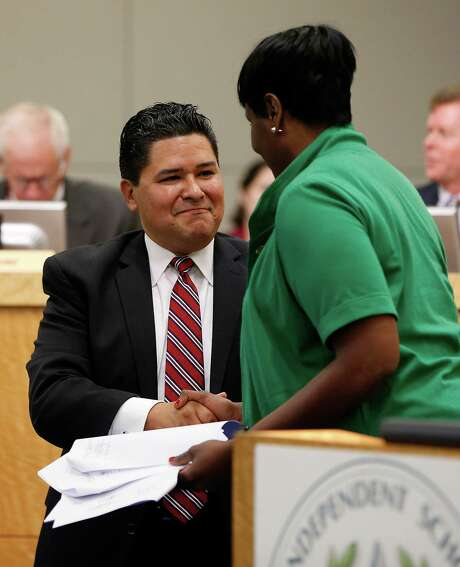 HISD Superintendent Richard Carranza shook hands with trustee Wanda Adams after signing his employment contract on Aug. 18. Photo: Karen Warren, Houston Chronicle / © 2016 Houston Chronicle