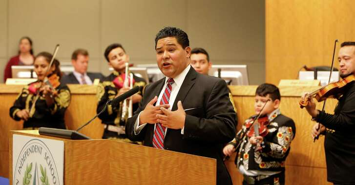 Richard Carranza sings with members of the Northside High School mariachi group who were present during the Houston school board meeting to officially hire him as the superintendent, Thursday, Aug. 18, 2016, in Houston.