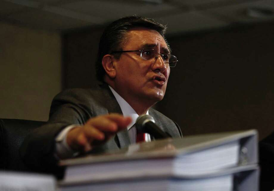 National Human Rights Commission President Luis Raul Gonzalez Perez Speaks during the presentation of a report about human rights abuses by Mexico's federal police, in Mexico City, Aug. 18, 2016. Gonzalez said that Mexico's federal police arbitrarily executed 22 people on May 22, 2015, at a ranch in the western state of Michoacan last year. (AP Photo/Moises Castillo) Photo: Moises Castillo, STF / AP