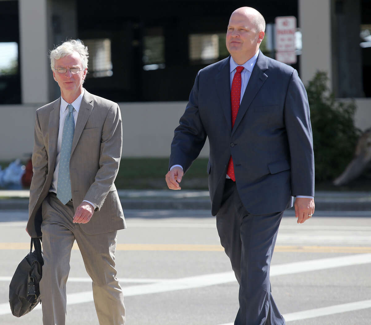 Mikal Watts, right, walks to the federal courthouse in Gulfport, Miss. with his attorney Robert McDuff for an initial appearance before U.S. Magistrate John Gargiulo on Thursday, Oct. 29, 2015. Mikal Watts, a Texas lawyer, his brother and a second employee of his law firm are among seven people accused of faking more than 40,000 damage claims after the BP oil spill in 2010, federal prosecutors said Thursday. (Amanda McCoy/The Sun Herald via AP) LOCAL TELEVISION OUT; MANDATORY CREDIT: MISSISSIPPI PRESS OUT; LOCAL TELEVISION OUT WLOX, LOCAL ONLINE OUT; GULFLIVE.COM OUT