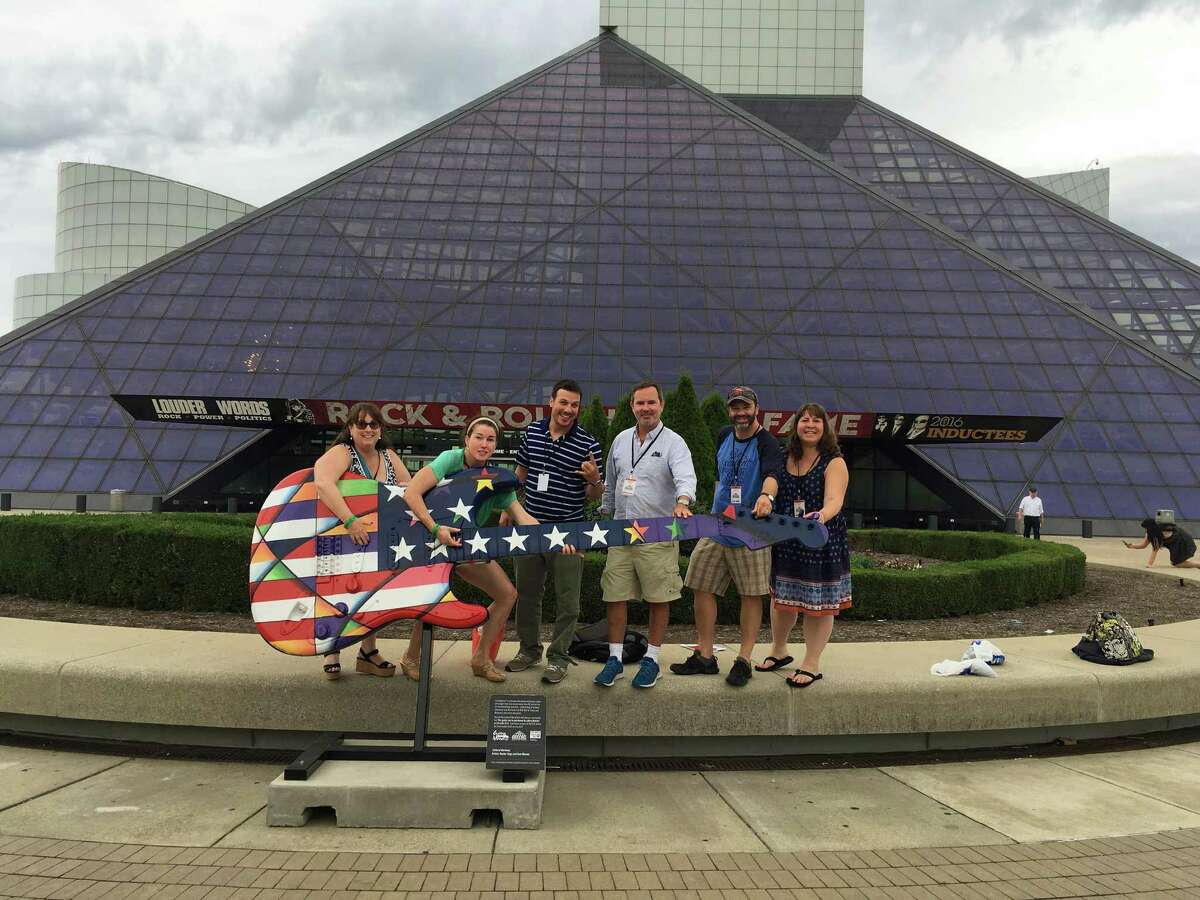 Lettitia Long, left, outside the Rock & Roll Hall of Fame in Cleveland, Ohio, where she attended a conference on bringing music into the classroom with six other tri-state area teachers.