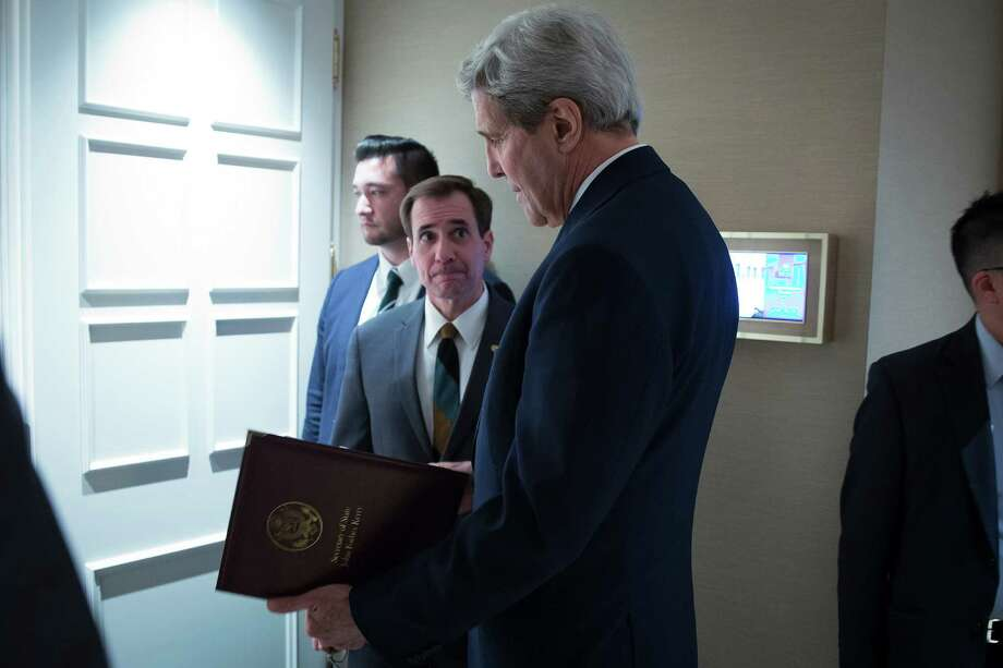 FILE - In this Oct. 23, 2015 file-pool photo, Secretary of State John Kerry, speaks to senior adviser John Kirby before a news conference in Vienna. The State Department says a $400 million cash payment to Iran was contingent on the release of American prisoners. Spokesman Kirby says negotiations over the U.S. returning Iranian money from a decades-old account was conducted separately from the prisoner talks. But he says the U.S. withheld delivery of the cash as leverage until the U.S. citizens had left Iran. (Carlo Allegri/Pool Photo via AP, File) Photo: Carlo Allegri, POOL / Pool Reuters