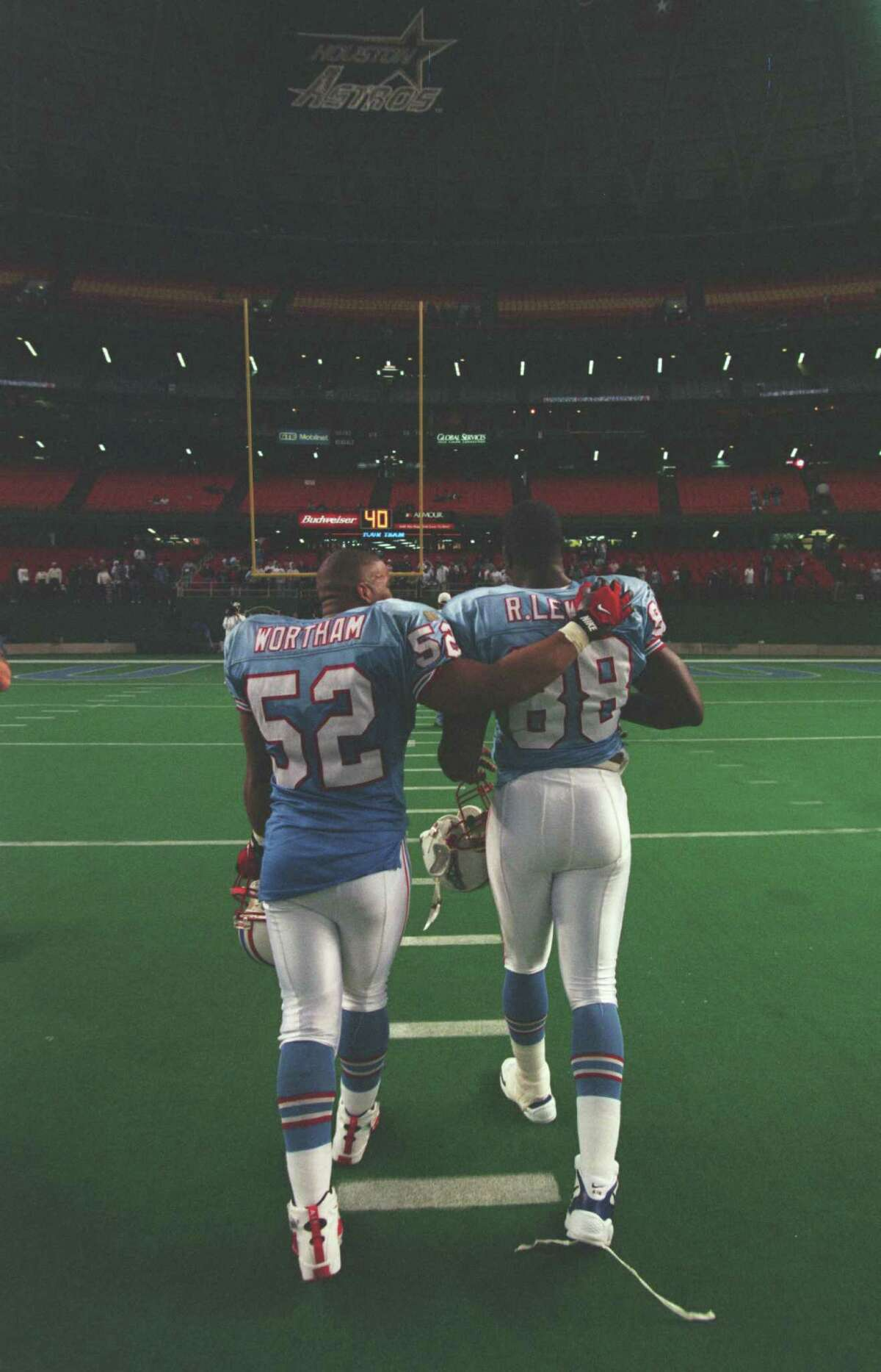 Barron Wortham and Reggie Lewis leave after the final Oilers game in the Astrodome, a loss to the Cincinnati Bengals. The Oilers moved to Nashville, Tenn., and eventually, a new stadium.