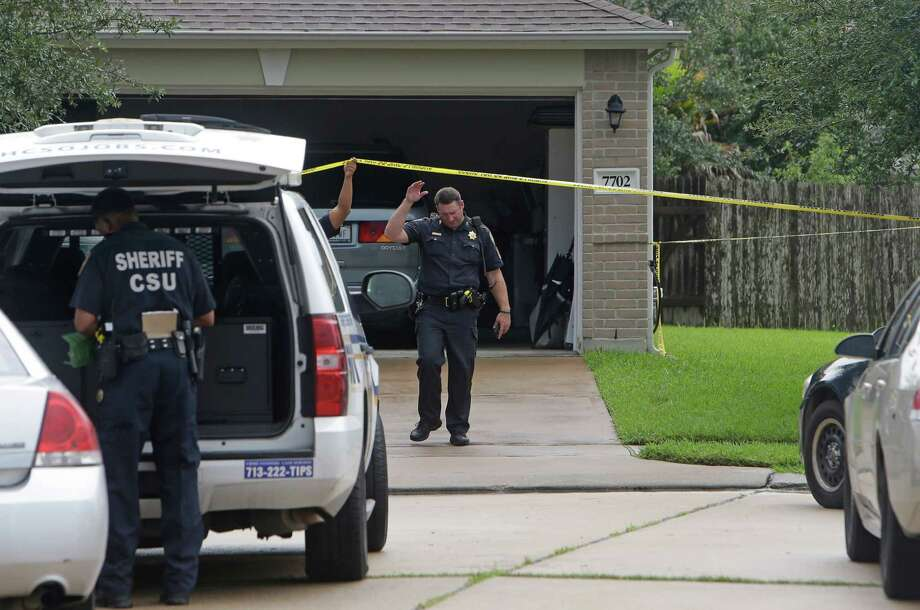 Police are shown at a scene where three elderly people were found dead in the backyard of a home in the 7700 block of Balsam Crossing Lane Thursday, Aug. 18, 2016, in Cypress.  ( Melissa Phillip / Houston Chronicle ) Photo: Melissa Phillip, Staff / © 2016 Houston Chronicle