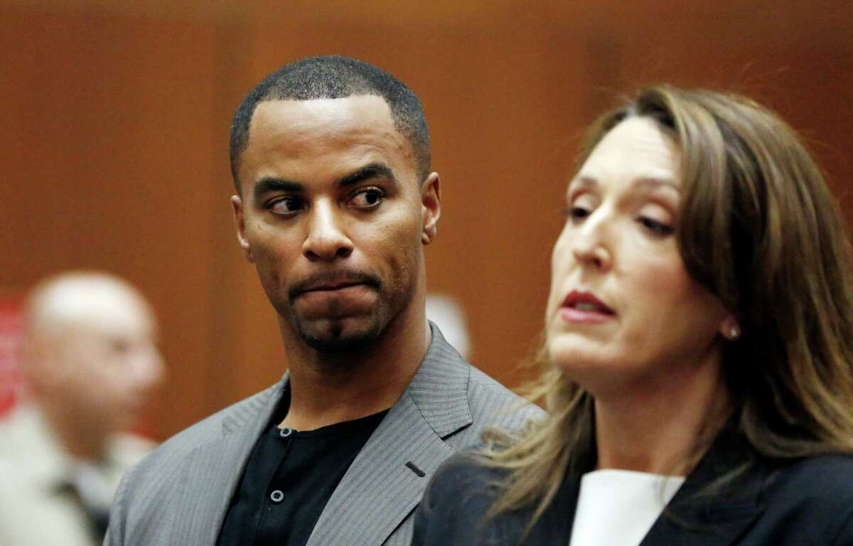 FILE - In this Feb. 20, 2014, file photo, Darren Sharper looks toward his attorney, Blair Berk, during an appearance in Los Angeles Superior Court in Los Angeles. Former NFL star Darren Sharper has been sentenced to 18 years in prison in a case where he was accused of drugging and raping as many as 16 women in four states. Judge Jane Triche Milazzo sentenced Sharper on Thursday, Aug. 18, 2016, in New Orleans. (AP Photo/Mario Anzuoni, Pool, File) ORG XMIT: NY163