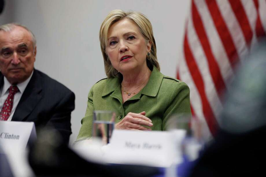 Hillary Clinton, joined by New York Police Department Commissioner Bill Bratton, left, and other law enforcement leaders on Thursday. Photo: Carolyn Kaster, STF / Copyright 2016 The Associated Press. All rights reserved. This material may not be published, broadcast, rewritten or redistribu