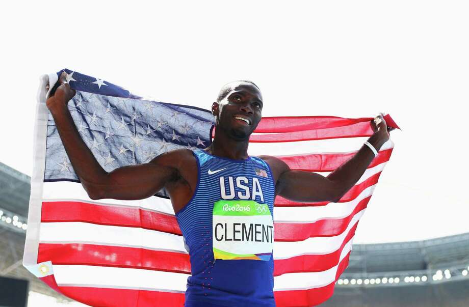 Kerron Clement's pre-Olympic planning pays off as he advised his mother to bring an American flag for the celebration of the gold medal he planned to win. Photo: Paul Gilham, Staff / 2016 Getty Images