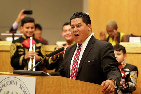 Richard Carranza sings with members of the Northside High School mariachi group who attended the Houston school board meeting Thursday.