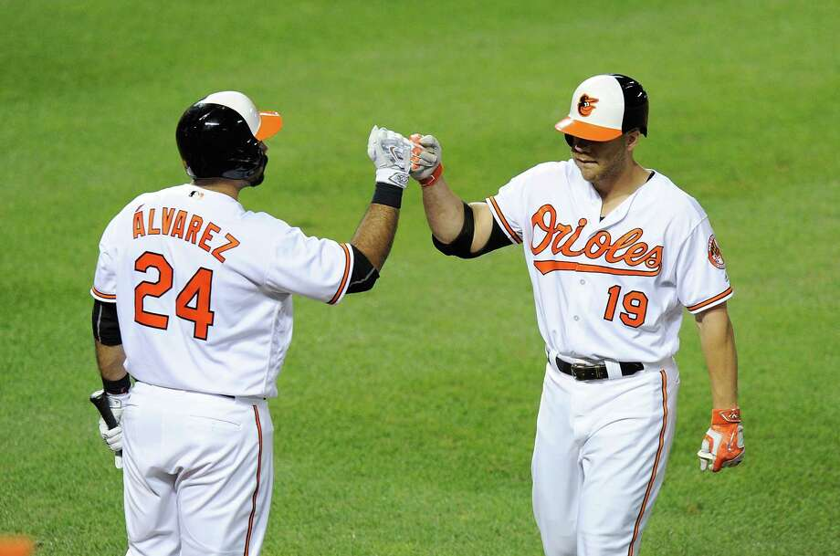 BALTIMORE, MD - AUGUST 18:  Chris Davis #19 of the Baltimore Orioles celebrates with Pedro Alvarez #24 after hitting a home run in the sixth inning against the Houston Astros at Oriole Park at Camden Yards on August 18, 2016 in Baltimore, Maryland.  Baltimore won the game 13-5. Photo: Greg Fiume, Getty Images / 2016 Getty Images