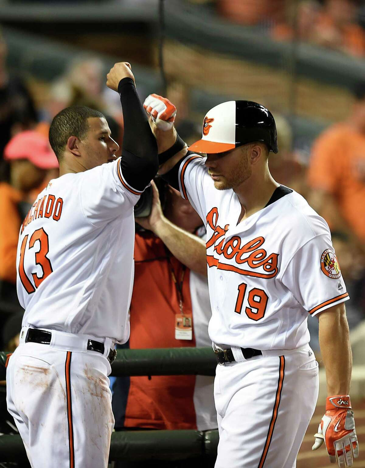 Baltimore Orioles' Chris Davis, right, is congratulated by Manny Machado after hitting a home run against the Houston Astros in the eighth inning of a baseball game, Thursday, Aug. 18, 2016, in Baltimore. It was Davis' second home run of the game. (AP Photo/Gail Burton)