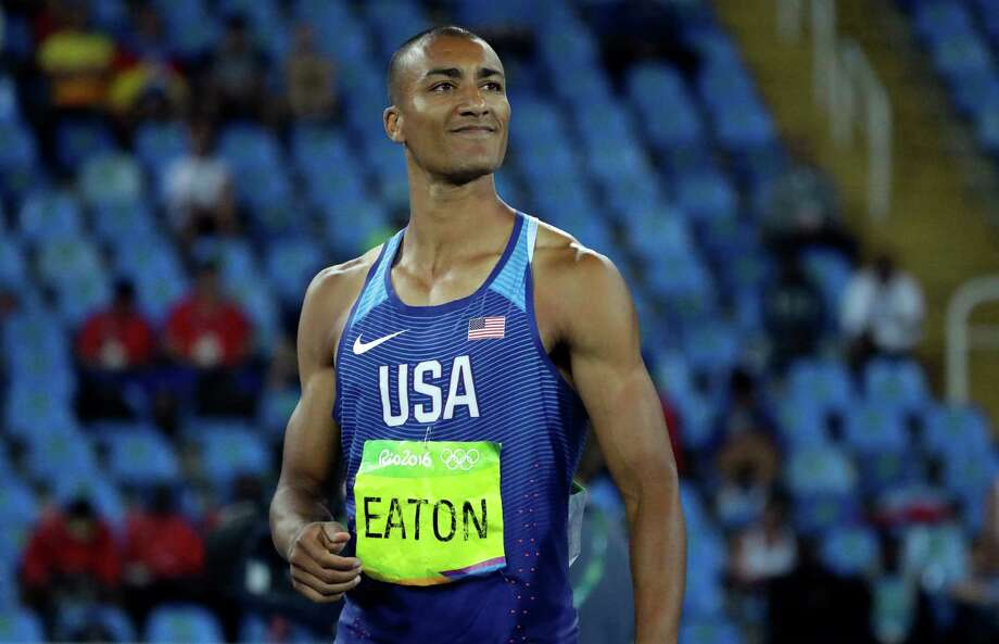 United States' Ashton Eaton smiles after an attempt in the javelin throw of the decathlon during the athletics competitions of the 2016 Summer Olympics at the Olympic stadium in Rio de Janeiro, Brazil, Thursday, Aug. 18, 2016. (AP Photo/Matt Dunham) Photo: Matt Dunham, STF / Copyright 2016 The Associated Press. All rights reserved. This material may not be published, broadcast, rewritten or redistribu